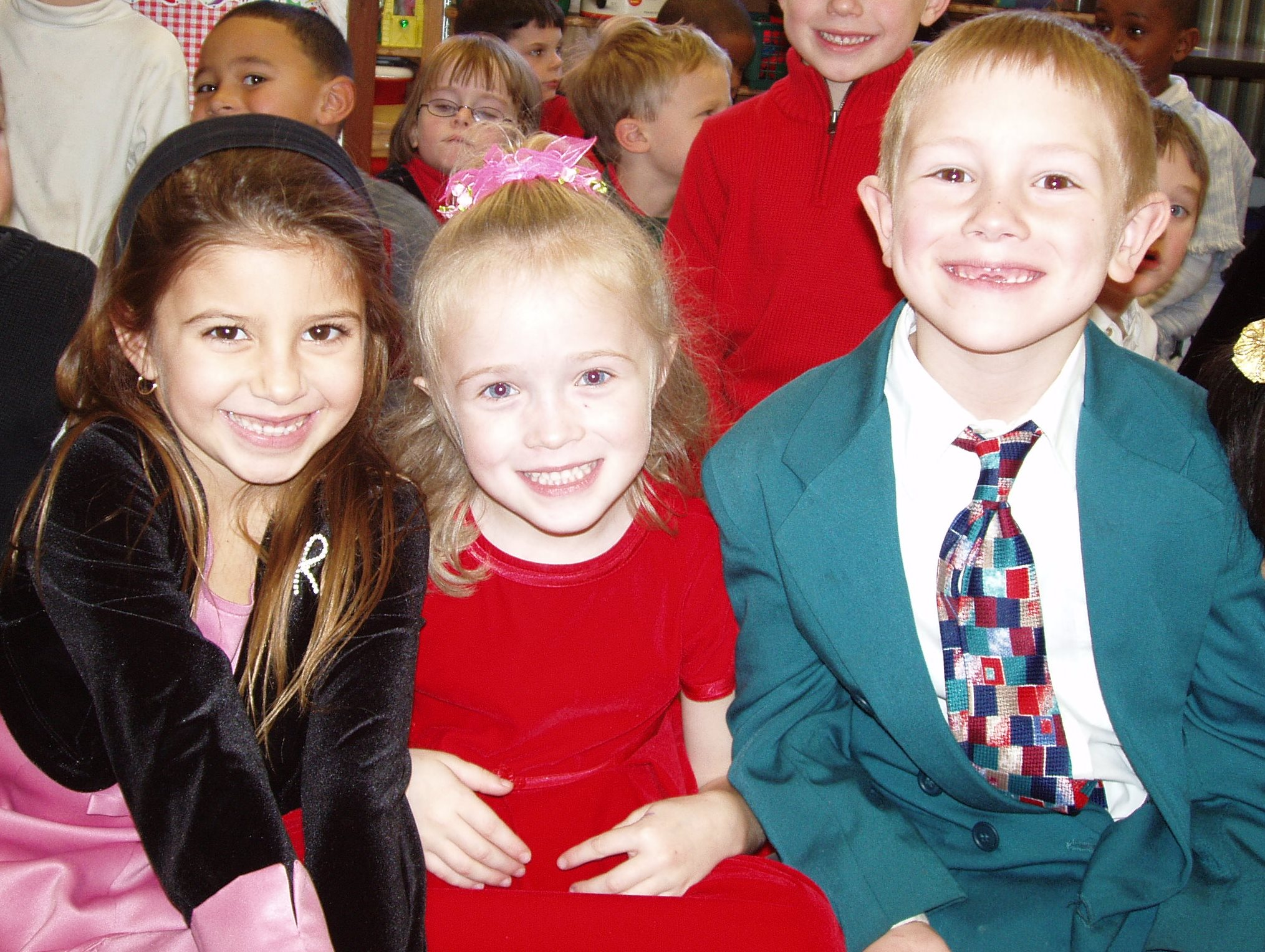 Young children all dressed up for Christmas Step by Step musical.