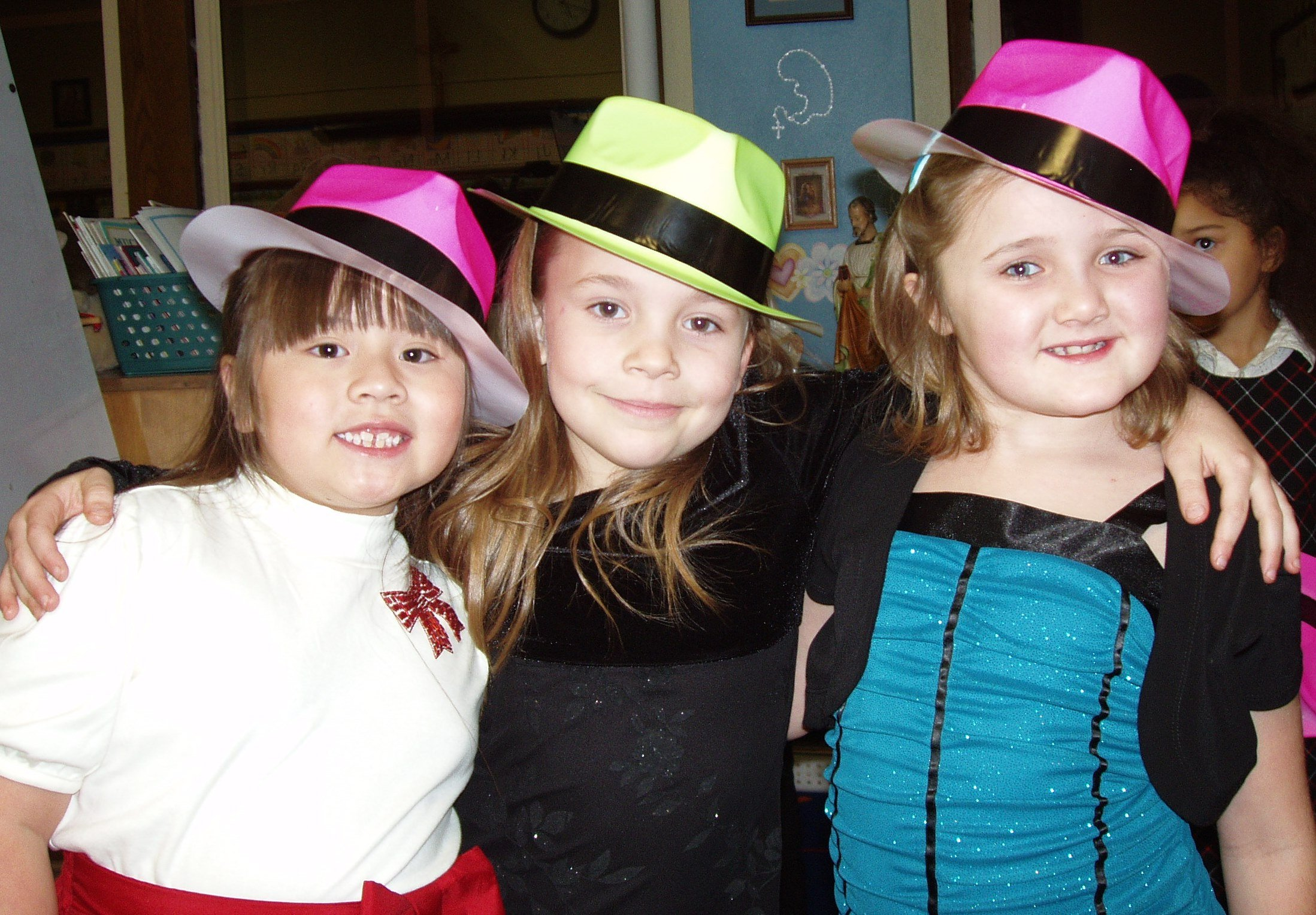 Children with hats in Hold on to Your Christmas program.
